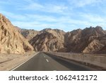 mountain road at hight speed... | Shutterstock . vector #1062412172