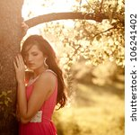 beautiful young woman in a pink ... | Shutterstock . vector #106241402