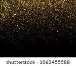 golden rain isolated on black... | Shutterstock . vector #1062455588