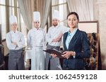 restaurant manager and his... | Shutterstock . vector #1062459128
