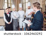 restaurant manager and his... | Shutterstock . vector #1062463292