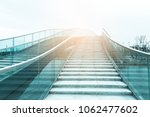 modern bridge with glass... | Shutterstock . vector #1062477602