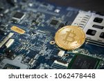 gold digital cryptocurrency... | Shutterstock . vector #1062478448