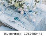 elegant table setup in blue... | Shutterstock . vector #1062480446