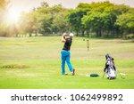 man hitting golf ball on a golf ... | Shutterstock . vector #1062499892