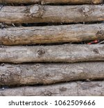 wood logs background. | Shutterstock . vector #1062509666