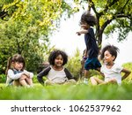 group of children playing... | Shutterstock . vector #1062537962