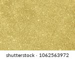 gold glitter background | Shutterstock . vector #1062563972