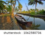 a country boat kept in a narrow ... | Shutterstock . vector #1062580736