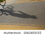 silhouette shadow of a cyclist... | Shutterstock . vector #1062603152