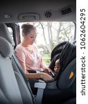 mother safely fastening and... | Shutterstock . vector #1062604295