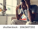 black guy talking phone with... | Shutterstock . vector #1062607202