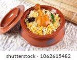 chicken biryani in handi ...   Shutterstock . vector #1062615482