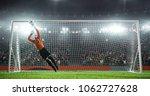 soccer goalkeeper in action on... | Shutterstock . vector #1062727628