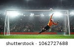 soccer goalkeeper in action on... | Shutterstock . vector #1062727688