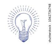 glowing incandescent light bulb ...   Shutterstock .eps vector #1062736748