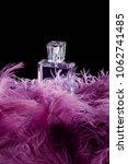 Bottle Of Perfume Standing On...