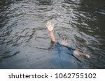 asian boy drowning in the pool... | Shutterstock . vector #1062755102
