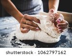 making dough by female hands at ... | Shutterstock . vector #1062797162