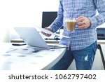 young businessman in casual... | Shutterstock . vector #1062797402