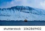 fishing vessel in the ocean... | Shutterstock . vector #1062869402