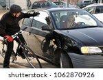 female car driver puts a... | Shutterstock . vector #1062870926