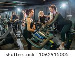 personal trainers talking with... | Shutterstock . vector #1062915005