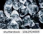 ice cubes on black background. | Shutterstock . vector #1062924005
