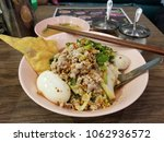 thai dry spicy noodle with soft ... | Shutterstock . vector #1062936572