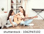 mom and her daughter are...   Shutterstock . vector #1062965102