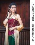 thai girl wearing thai dress... | Shutterstock . vector #1062968042