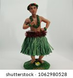 hawaiian hula male doll | Shutterstock . vector #1062980528