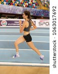 Small photo of ISTANBUL, TURKEY - DECEMBER 24, 2017: Undefined athlete running during Turkish Athletic Federation Indoor Athletics Record Attempt Races