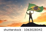 brazil flag being waved by a... | Shutterstock . vector #1063028342