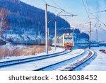 freight train moves along... | Shutterstock . vector #1063038452