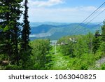 cable way above the green... | Shutterstock . vector #1063040825