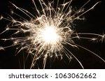 close up of an burning sparkler ...   Shutterstock . vector #1063062662