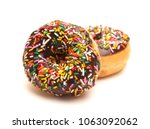 chocolate sprinkle donuts on a... | Shutterstock . vector #1063092062