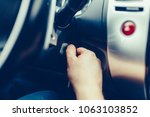 the driver of the man gets a... | Shutterstock . vector #1063103852