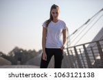 sports woman in a white t shirt ... | Shutterstock . vector #1063121138
