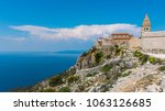 ancient fort city lubenice on... | Shutterstock . vector #1063126685