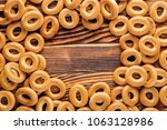 heap of bagels scattered on the ... | Shutterstock . vector #1063128986