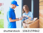 smiling delivery man in blue... | Shutterstock . vector #1063159862