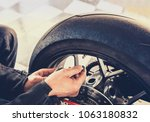 man checking air pressure of... | Shutterstock . vector #1063180832