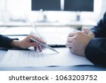man hand signing contract. | Shutterstock . vector #1063203752