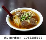 braised beef in broth with...   Shutterstock . vector #1063205936