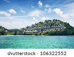 Over water bungalows in palms nature with beach - stock photo