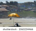 golden sunshade contrasting... | Shutterstock . vector #1063234466