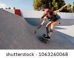 skater female rides on...   Shutterstock . vector #1063260068