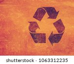 recycle sign old paper texture... | Shutterstock . vector #1063312235
